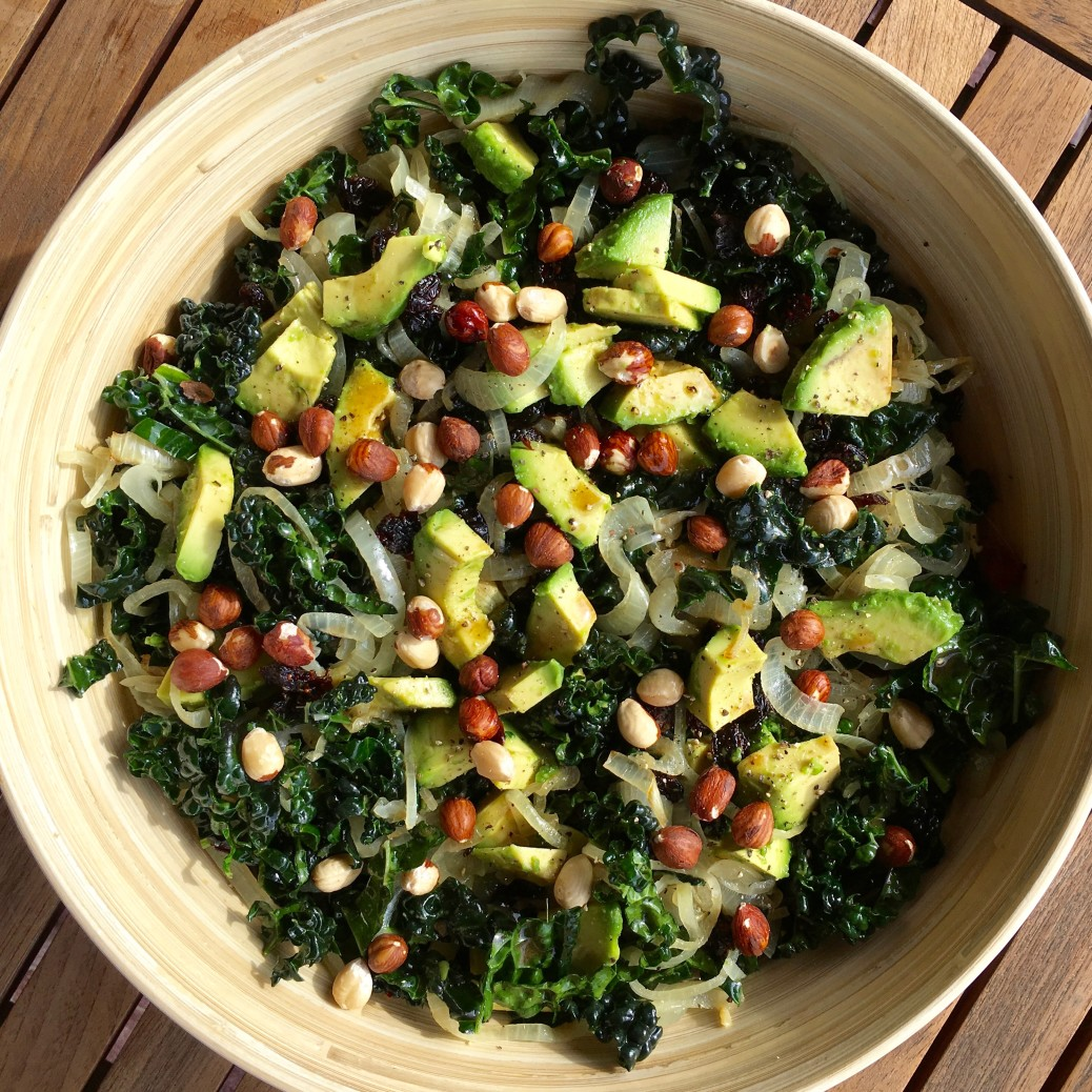 Kale Salad with avocado, onions, nuts and cranberries